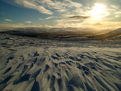 Photo of Wind-swept snowy slope, viewing Newtonmore village