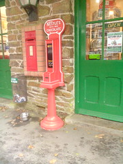 Photo of Woody Bay post box and chocolate machine.