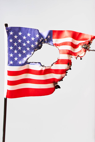 Burned US national flag against bright background, From FlickrPhotos