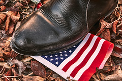 A protesters step on American flag