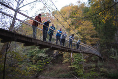 Team across suspension bridge