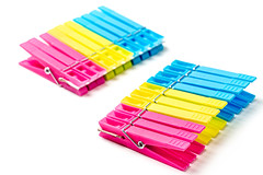 Pink, yellow and blue plastic clothespins