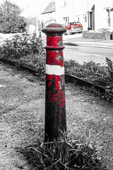 Photo of Red Post, Red Car