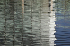 Photo of 22nd January 2021. Reflections in the Manchester Ship Canal at Salford Quays, Greater Manchester.