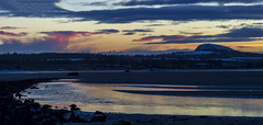 Photo of Tyne estuary on Sandy Hirst looking towards a snowy Traprain Law at sunset