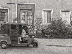 Bajaj and bike: Stone Town