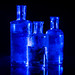 "Blue Mini bottles on a black Background - My entry for todays ""Looking close... on Friday!"" theme ""Blue on black background"""