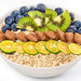 The concept of a delicious and healthy breakfast - oatmeal and fruits