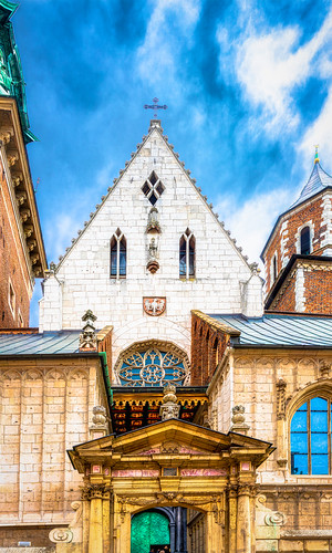 Multiphoto panorama of the details of the top portions of the entrance to the Wawel Cathedral at the Wawel Castle, Krakow, Poland.  The green door is the main entrance.  942-Pano-Edita