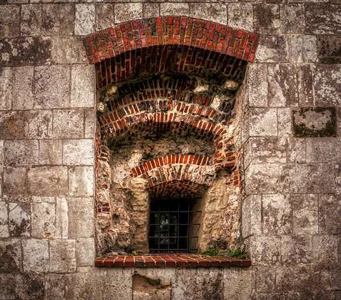Close up view of a thick wall and window on the northwestern external wall of the Wawel Castle, Krakow, Poland.  947-Edita