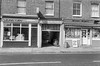 Shops, Spiritualist Church entrance, North St, Clapham, Lambeth, 1989 89-5h-21