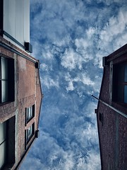 55/365 I had some business down in Carlton this morning so I decided to wander around some lanes and thought the sky showing between these two buildings was pretty dramatic.