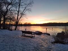 2-17-2021: Sun sets on the hockey players. Arlington, MA