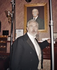 Dr Watson (David Burke) poses by Jean Upton's portrait of Sir Arthur Conan Doyle (photo by Jean Upton)