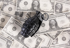 Black Grenade on dollar banknote. Military industry, war, global arms trade and crime concept.