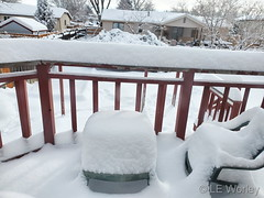 February 25, 2021 - A snow-covered deck in Thornton. (LE Worley)