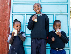 Children at Simon and Sylvia's dairy farm in Meru, Kenya, drinking milk.