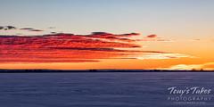 A frozen lake at sunrise