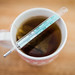 Close-up of a mercury thermometer on a cup of tea