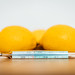 Close-up of a mercury thermometer leaning on lemons. Boosting immune system during the Coronavirus global pandemic