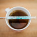 Mercury thermometer on a cup of tea. Riding out Coronavirus at home