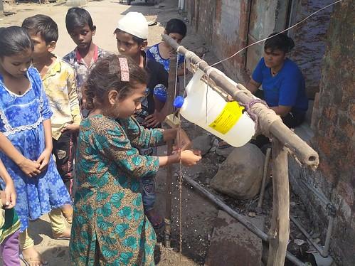 Children using hand wash station