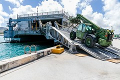 NMCB-4 load civil engineer support equipment aboard USNS Fall River (T-EPF 4) during a mount-out exercise at Naval Base Guam.