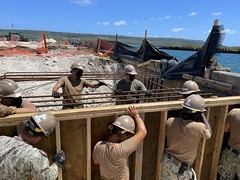 Seabees assigned to NMCB-4 install formwork alongside rebar in preparation for the mooring bollard concrete placement at the Tinian. Harbor.
