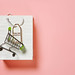 Shopping bag and shopping cart on pink background