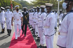 Adm. Robert P. Burke inspects the Ghanaian navy's honor guard during the opening ceremony of Exercise Obangame Express 2021.