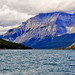 Where the slopes of the mountains reach Lake Minnewanka