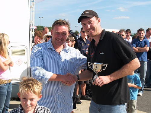 Wayne Ashford receives trophy from Simon Griffiths