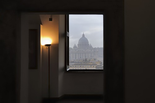 St Peter's Basilica in urban haze - through window of Castel Sant'Angelo in Parco Adriano.