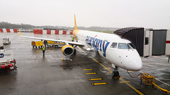Aurginy Embraer 195 at the gate at London Gatwick Airport