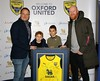 Andy Whing presents a framed shirt to the sponsors