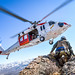 """An MH-60S Knighthawk helicopter assigned to the """"Longhorns"""" of Helicopter Search and Rescue (SAR) Squadron, practices pinnacle landings and extractions during a mountain flying SAR training event."""