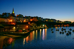 Photo of Tenby town from the harbour at dusk