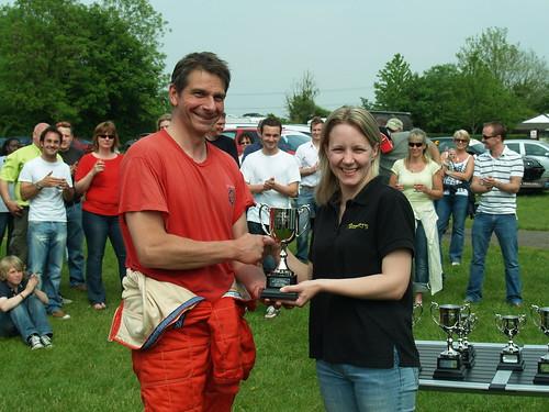 Emma presents teophy to winner Tim Lewis