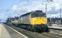 Photo of Railfreight Grey 47 On Two Wagons At Wigan.