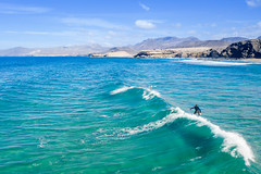 Surfing in la Pared on Fuerteventura, Canary Islands