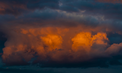 Sunset glow enlightening the stormy sky, Madrid, Spain