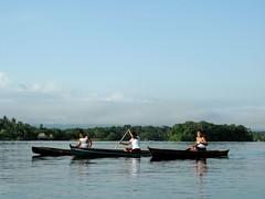 Women canoeing in Rio Dulce, Guatemala