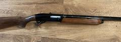 Remington 1100. Reblued and stock refinished. Complete restoration