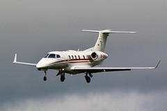 Photo of Embraer EMB 505 Phenom 300 - Atlas Air Service arrives at a cloudy Oxford / London Airport .