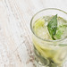 Mojito cocktail or non-alcohol drink with mint and sliced kiwi fruits