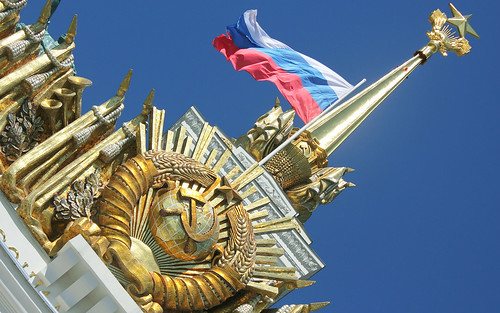 """Russian Federation, Moscow VDNKH (ВДНХ), Soviet Architecture, Flag of Russia flies on the flagpole of the Pavilion № 1 """"Central"""" (former """"Main"""" since 1954 and """"USSR""""), Mira Avenue, Ostankinsky district."""