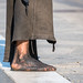 Barefoot in the city of Milan, Italy