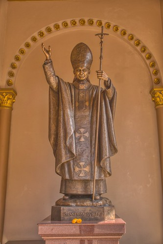 Statue of Pope John Paul II at Assumption Cathedral by the Chao Phraya river in Bangkok, Thailand