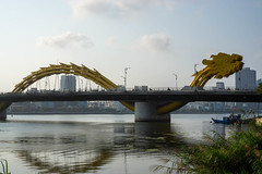 Sunset at the Iconic Dragon Bridge with Reflection in Han River with Buildings in the Background in Da Nang, Vietnam