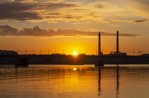 sunset over the Saint Petersburg City with visual elements of tomorrow solar eclipse